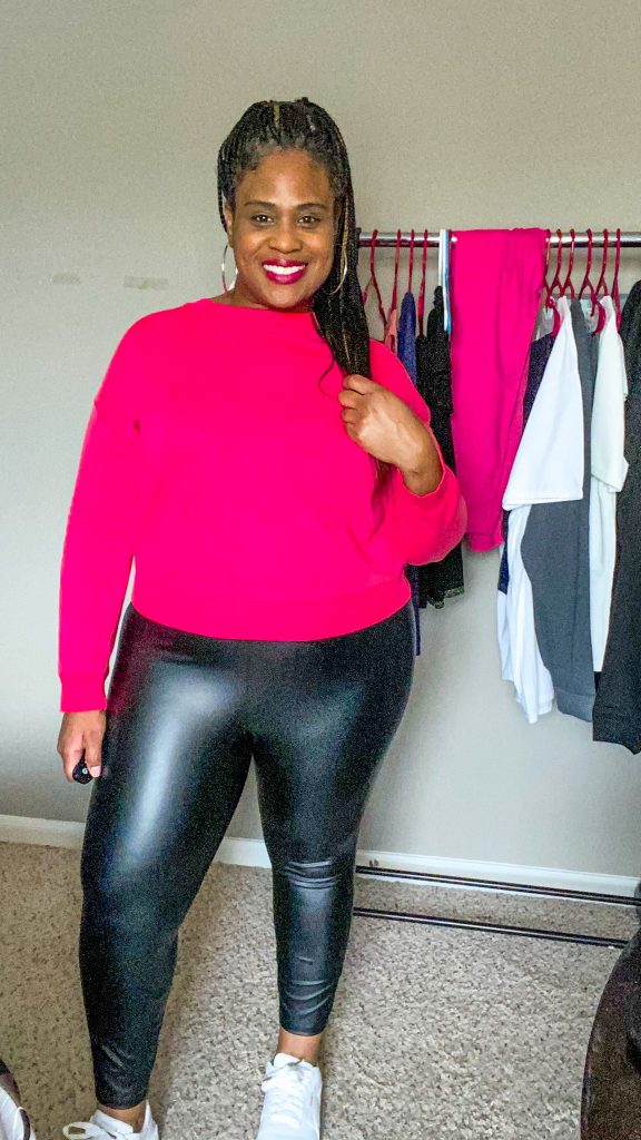 woman wearing plus size faux leather leggings with pink shirt